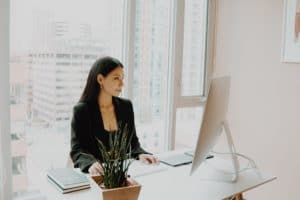 Picture of a woman looking at her computer screen in an office.